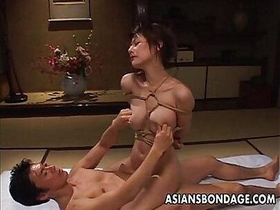 Curvy asian babe held in bondage