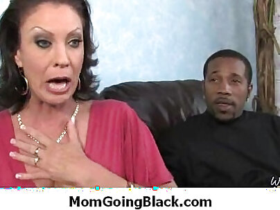 black mom is getting her pussy lips stretched by four kinky dudes