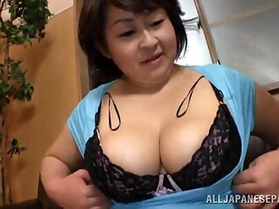 Fat Japanese woman gives a titjob and sucks dick