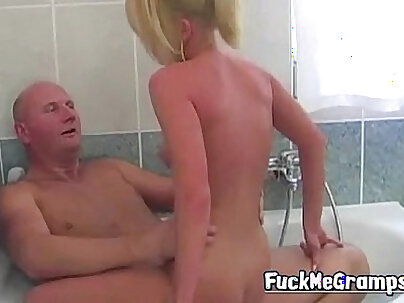 Blonde slut in glasses takes a hot bath and spits in his face