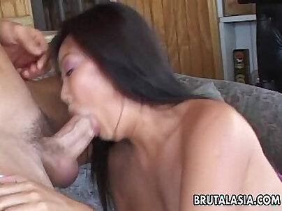 Asian lover riding cock on couch
