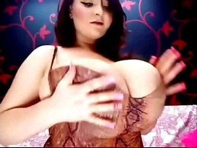 blunette with large boobs enjoys masturbating on webcam